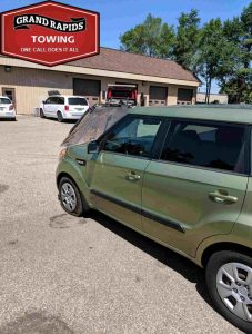 Towing Company Car delivered to repair shop Grand Rapids