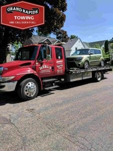 Towing Company Car on Flatbed Grand Rapids