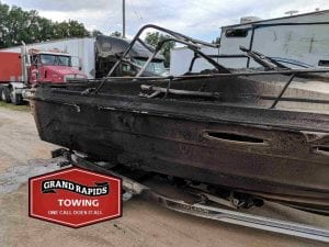 Check out side of boat after fire and see why 24-hour towing was needed