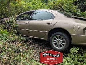 Car smashed after-running into a ditch before tow company called